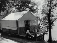 Two students meet on a tent platform in the Tent Colony circa 1950.