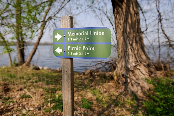 A sign providing directions to the Memorial Union and Picnic Point is pictured along the Howard Temin Lakeshore Path at the University of Wisconsin-Madison during spring on May 10, 2011.