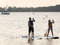 Students paddle on Lake Mendota